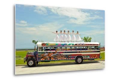Ballerinas Dance on Top of a Diablo Rojo Bus on La Cinta Costera, Panama's Coastal Highway-Kike Calvo-Metal Print
