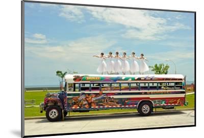 Ballerinas Dance on Top of a Diablo Rojo Bus on La Cinta Costera, Panama's Coastal Highway-Kike Calvo-Mounted Premium Photographic Print