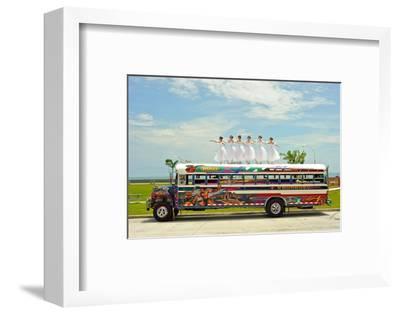 Ballerinas Dance on Top of a Diablo Rojo Bus on La Cinta Costera, Panama's Coastal Highway-Kike Calvo-Framed Photographic Print