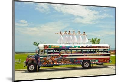 Ballerinas Dance on Top of a Diablo Rojo Bus on La Cinta Costera, Panama's Coastal Highway-Kike Calvo-Mounted Photographic Print
