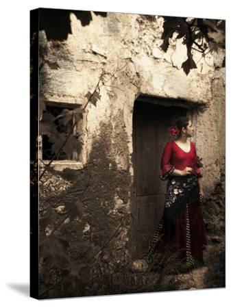 A Young Spanish Woman Wearing Traditional Flamenco Dress Standing in a Doorway to an Old Building-Steven Boone-Stretched Canvas Print