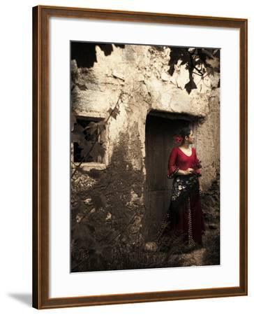 A Young Spanish Woman Wearing Traditional Flamenco Dress Standing in a Doorway to an Old Building-Steven Boone-Framed Photographic Print