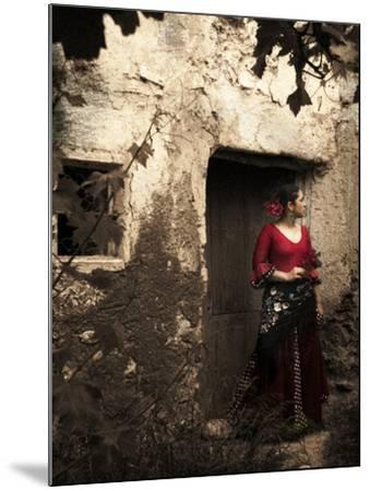 A Young Spanish Woman Wearing Traditional Flamenco Dress Standing in a Doorway to an Old Building-Steven Boone-Mounted Photographic Print