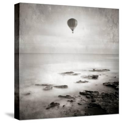A Hot Air Balloon Floating Above the Sea-Luis Beltran-Stretched Canvas Print