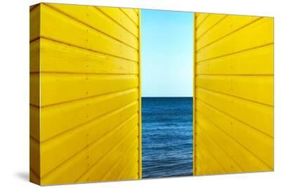 2 Yellow Beach Huts-Andy Bell-Stretched Canvas Print