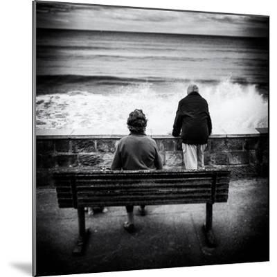 Elderly Couple Watch the Waves-Rory Garforth-Mounted Photographic Print