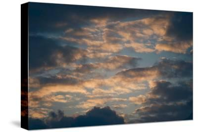 Dark Clouds over a Hilly Landscape at Sunset-Clive Nolan-Stretched Canvas Print