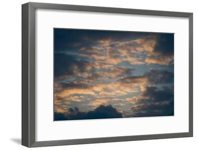 Dark Clouds over a Hilly Landscape at Sunset-Clive Nolan-Framed Photographic Print