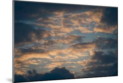 Dark Clouds over a Hilly Landscape at Sunset-Clive Nolan-Mounted Photographic Print
