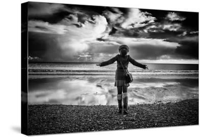 Young Girl Standing on a Beach-Rory Garforth-Stretched Canvas Print