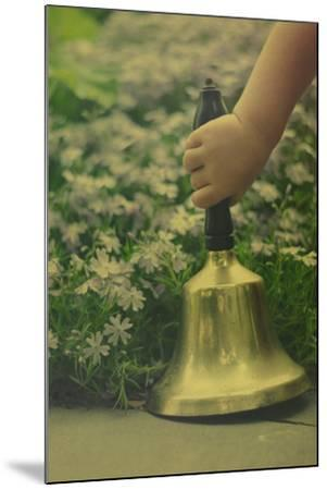 Child's Hand Holding Bell-Elizabeth Urqhurt-Mounted Photographic Print