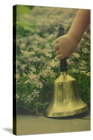 Child's Hand Holding Bell-Elizabeth Urqhurt-Stretched Canvas Print