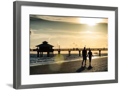 Loving Couple walking along the Beach at Sunset-Philippe Hugonnard-Framed Photographic Print