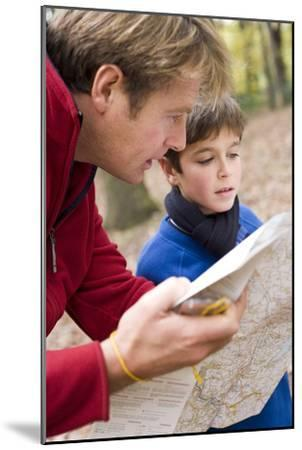 Father And Son Reading a Map-Ian Boddy-Mounted Photographic Print
