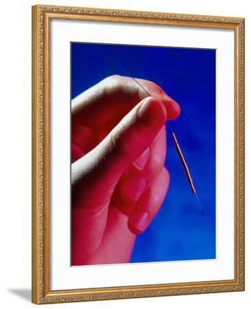 Hand Holds a GyneFIX Intrauterine Contraceptive-Damien Lovegrove-Framed Photographic Print