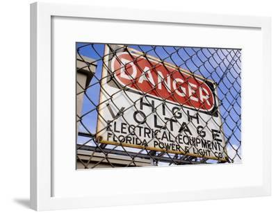 Danger High Voltage Sign In Cocoa Florida-Mark Williamson-Framed Photographic Print