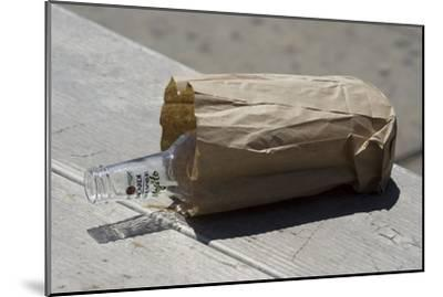 Discarded Rum Bottle In Paper Bag-Mark Williamson-Mounted Photographic Print