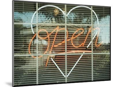 Neon 'Open' sign framed in a heart-shape in a window--Mounted Photographic Print