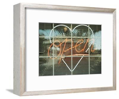 Neon 'Open' sign framed in a heart-shape in a window--Framed Photographic Print