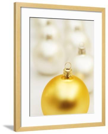 White Christmas tree decorations and a yellow one--Framed Photographic Print