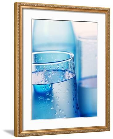 Bottle and glasses of water--Framed Photographic Print