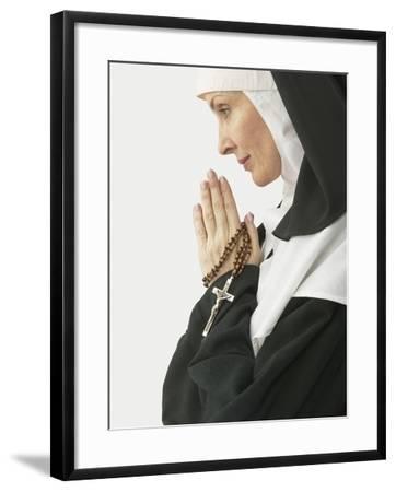 Praying Nun Holding Rosary--Framed Photographic Print