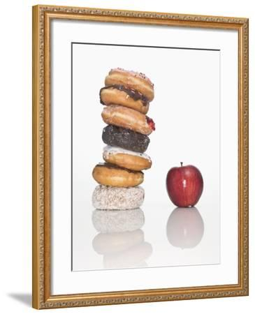 Stack of Donuts and One Apple--Framed Photographic Print