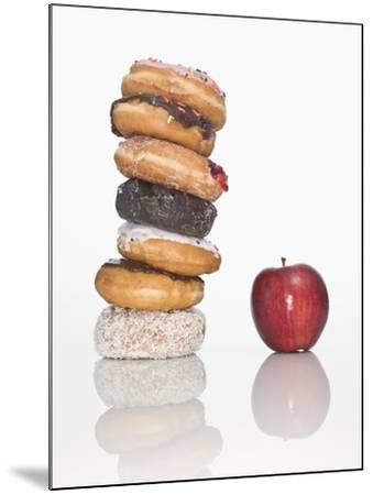 Stack of Donuts and One Apple--Mounted Photographic Print