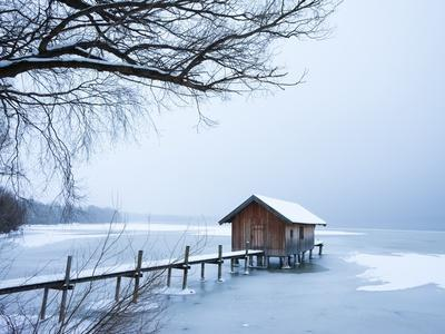 Snow covered pier and boat house at Lake Starnberg-Frank Lukasseck-Framed Photographic Print