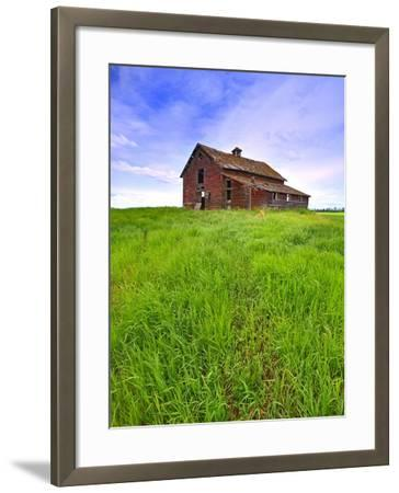 Abandoned red barn sitting on the top of a hill on a pioneer homestead in rural Alberta Canada-Robert McGouey-Framed Photographic Print