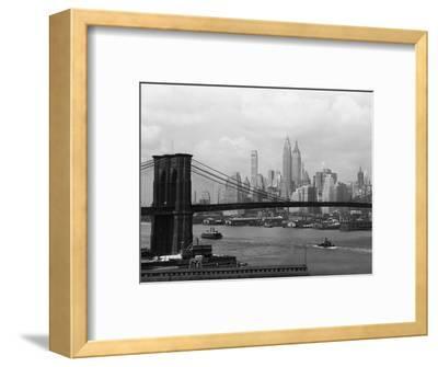 Manhattan Skyline And Brooklyn Bridge-Bettmann-Framed Photographic Print