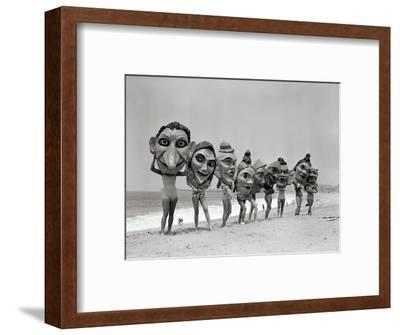 Women Holding Giant Masks-Bettmann-Framed Photographic Print