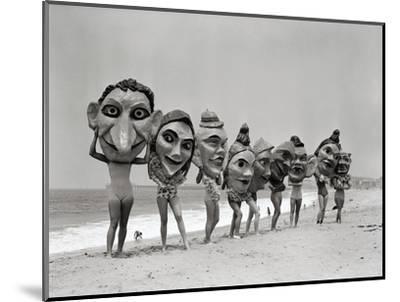 Women Holding Giant Masks-Bettmann-Mounted Photographic Print