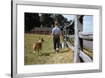 Boy and His Dog Walking Along a Fence-William P^ Gottlieb-Framed Photographic Print