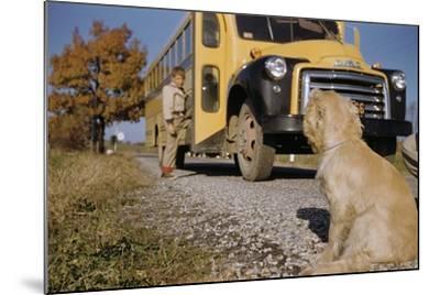 Faithful Dog Watching Boy Enter School Bus-William P^ Gottlieb-Mounted Photographic Print