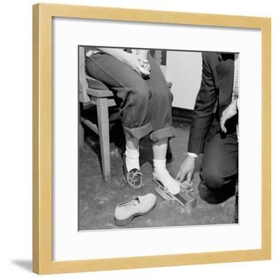 Salesmen Helps Woman with Safety Work Shoes, Ca. 1943--Framed Photographic Print