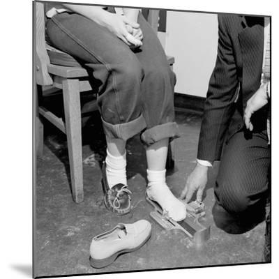 Salesmen Helps Woman with Safety Work Shoes, Ca. 1943--Mounted Photographic Print