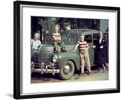 A Family Poses on and around their Plymouth Automobile, Ca. 1953--Framed Photographic Print