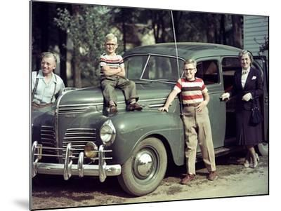 A Family Poses on and around their Plymouth Automobile, Ca. 1953--Mounted Photographic Print