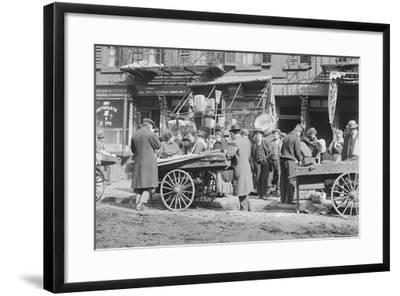 People Shopping around Push Cart--Framed Photographic Print