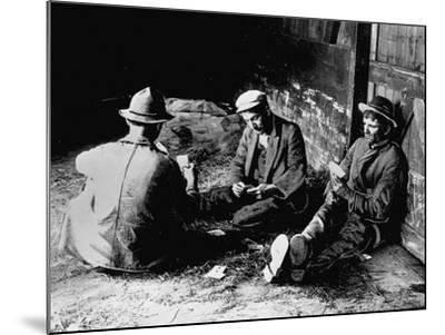 Vagrants Playing Cards in Railroad Car--Mounted Photographic Print