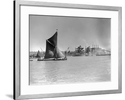Sailboat Passes Ford Motor Works--Framed Photographic Print