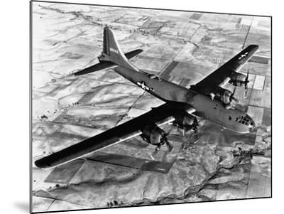 B-29 Flying over Japan's Countryside--Mounted Photographic Print