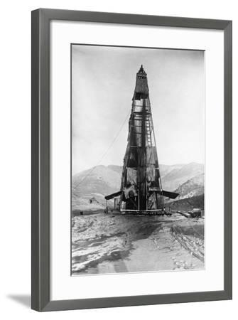 Oil Flowing in a Derrick--Framed Photographic Print