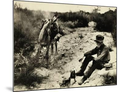 Prospector Preparing Meal for Himself--Mounted Photographic Print