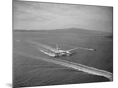 Howard Hughes' Spruce Goose Taxiing across Water--Mounted Photographic Print