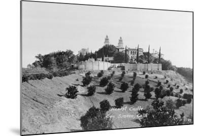 Exterior View of William R. Hearst's Castle with Landscape--Mounted Photographic Print
