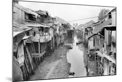 Scene of Squalid Living Area in Village-Nat Gibson-Mounted Photographic Print