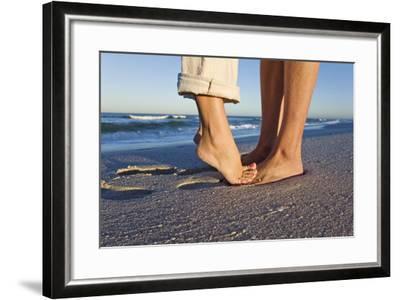 Feet of Couple Hugging on Beach-Martin Harvey-Framed Photographic Print