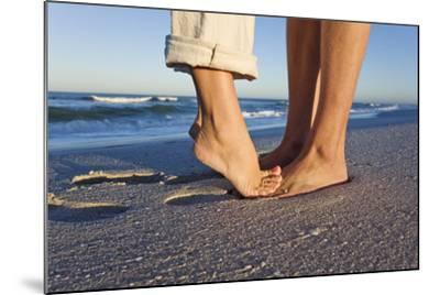 Feet of Couple Hugging on Beach-Martin Harvey-Mounted Photographic Print